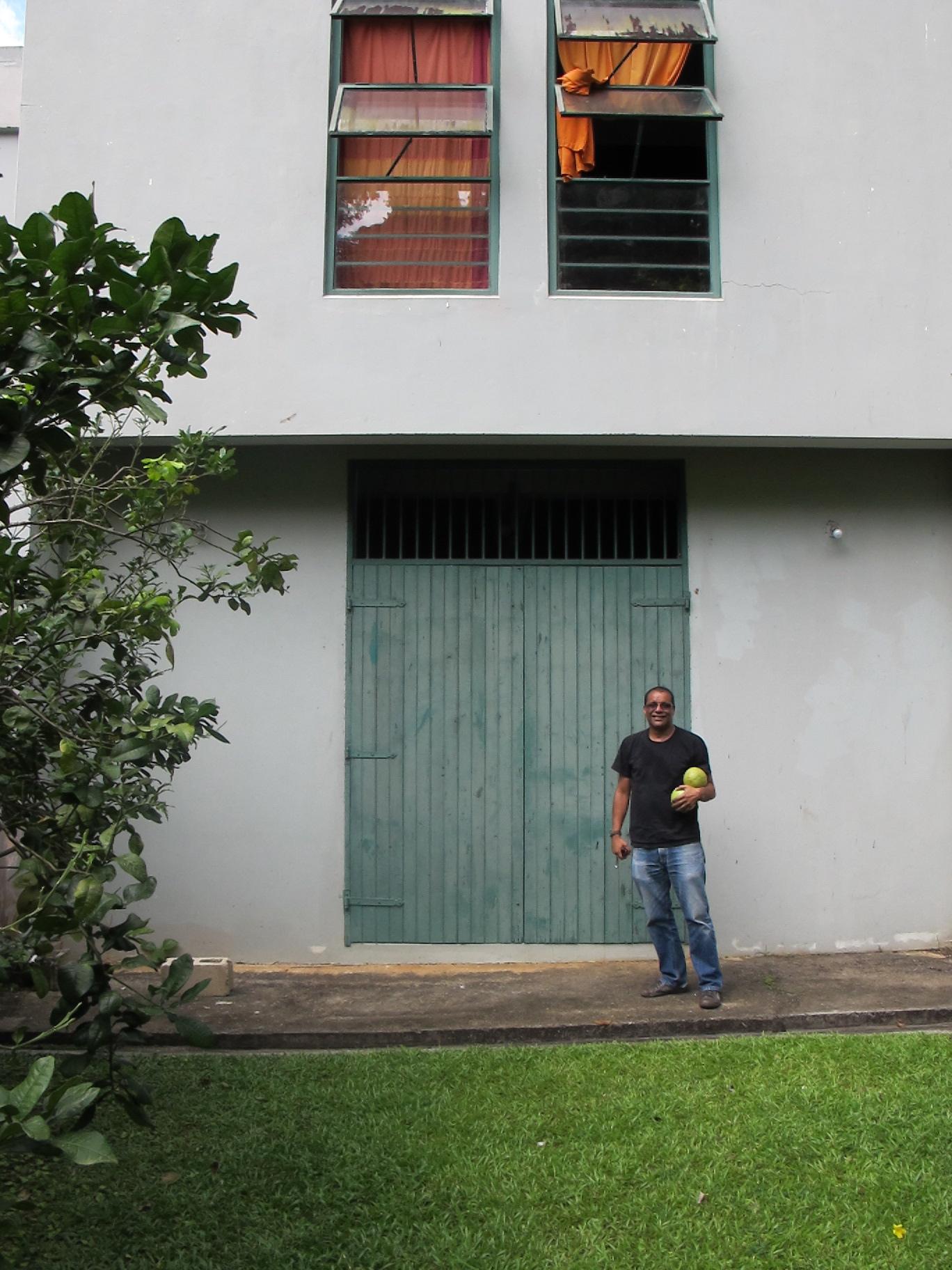 Cozier standing outside his studio doors