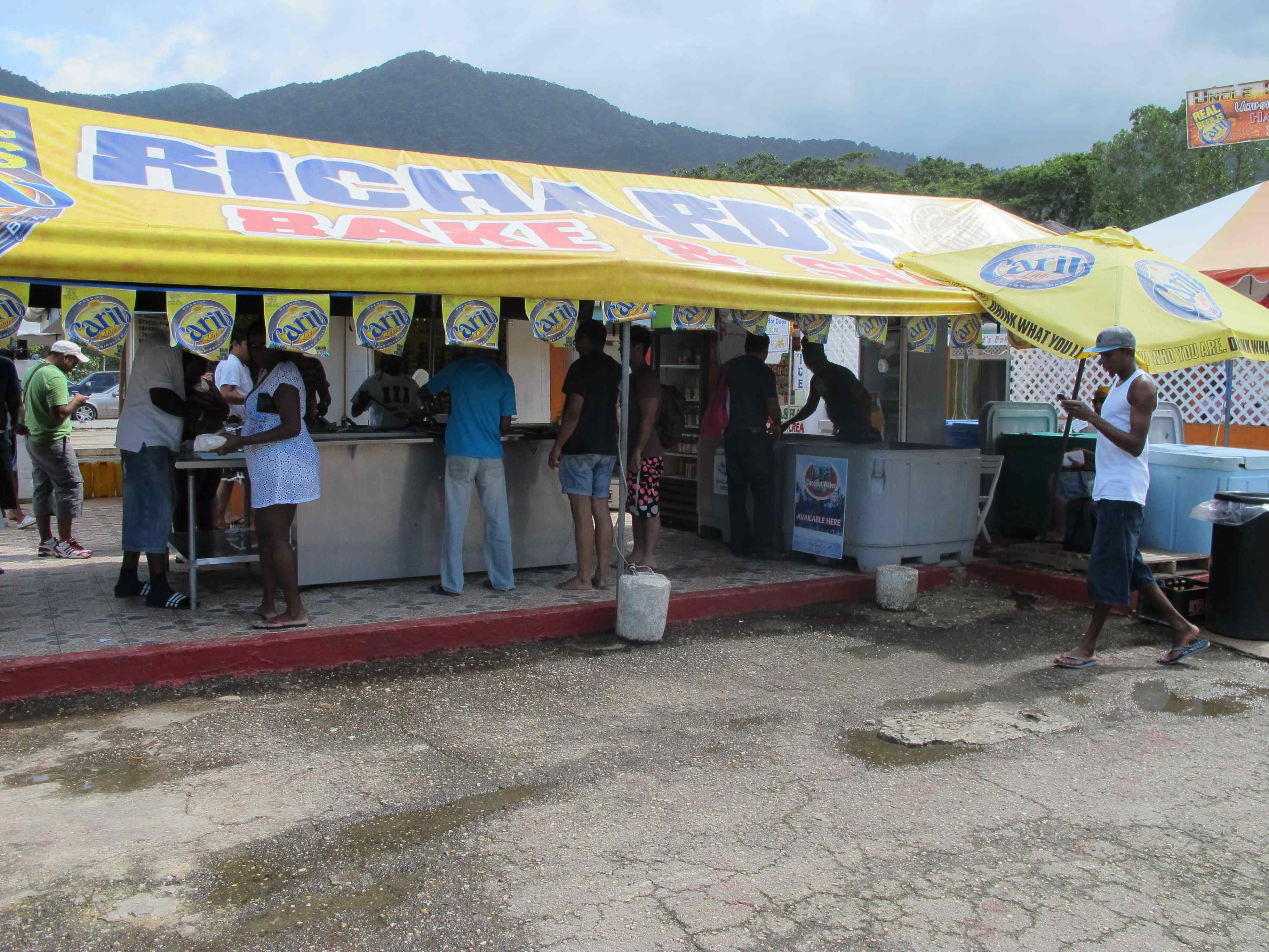 The famous Richard's Bake and Shark, a fried fish sandwich with a unique and delicious buffet of toppings, Maracas Beach