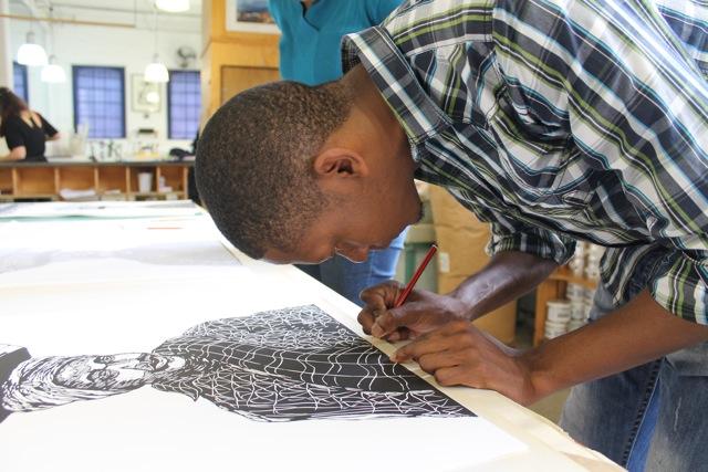 Senzo Shabangu signing new linocut