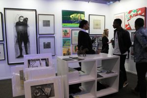 Negiste Yesside Johnson in conversation with visitors to the DKP booth