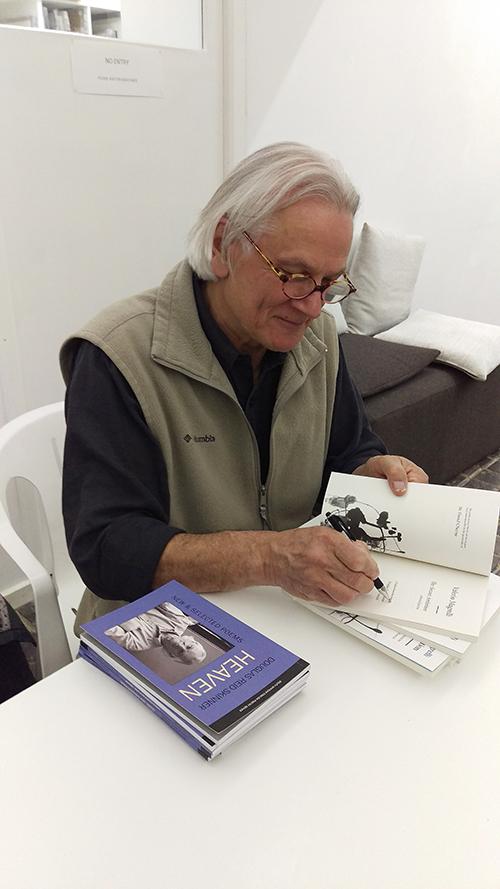 Douglas Reid Skinner signing a book