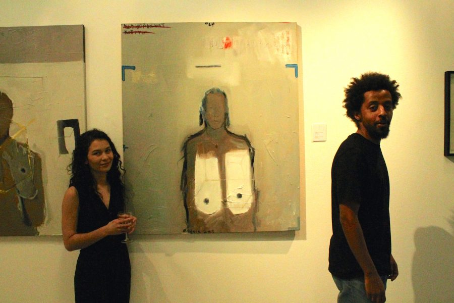 "Endale posing with printer Kim-Lee Loggenberg by his painting, ""Alem's Breast""."