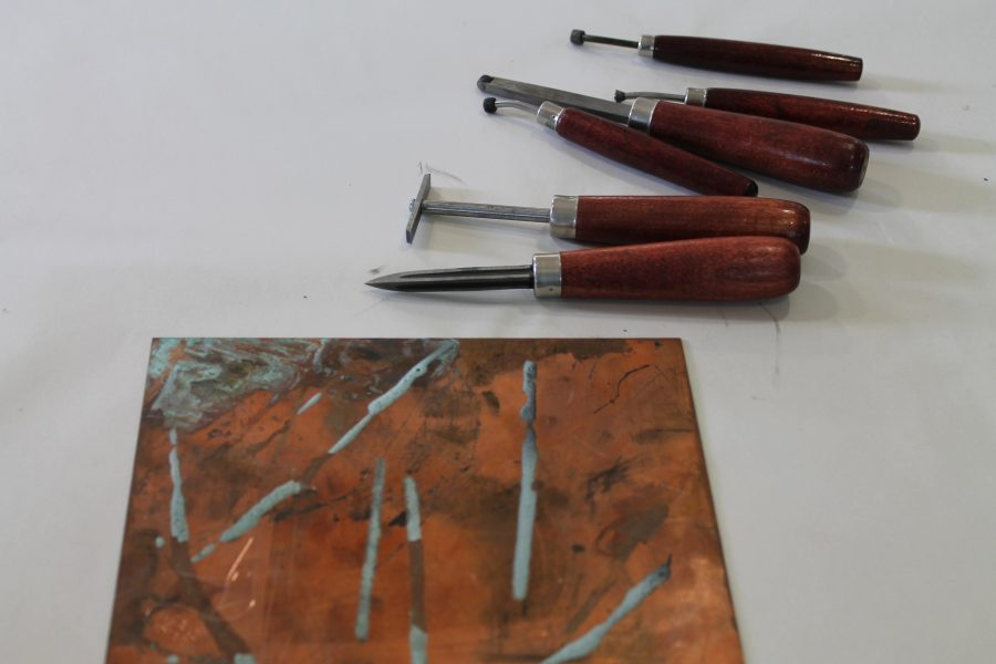 The basic printmaker's toolbox: varying needles and a plate.