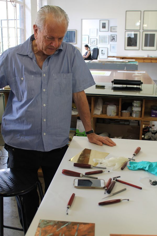 David Krut comes into the workshop to check on M's progress.
