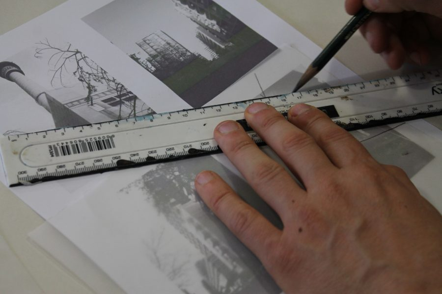 Nassimbeni demonstrates the tracing process, using a printout of his photographs in place of his phone.