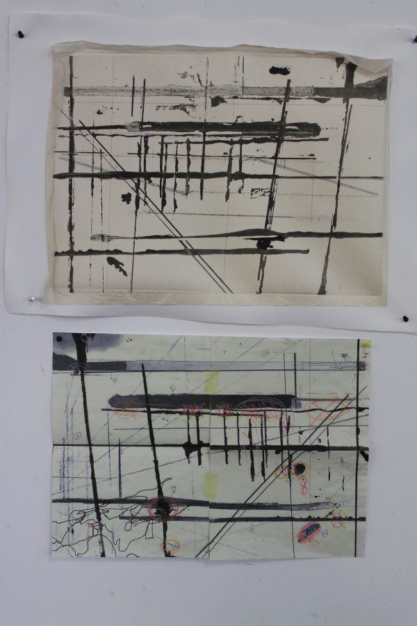 Proofs of two of the prints are pinned to the wall above the drawings that they are based on. The same design can be seen in the prints in reverse. The third print as conceptualised later in the process.