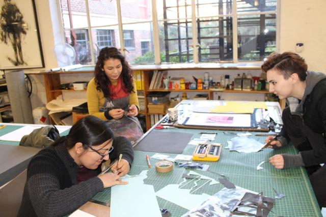 Joanna and Ryn get stuck in under the guidance of DKW printer Kim-Lee Loggenburg