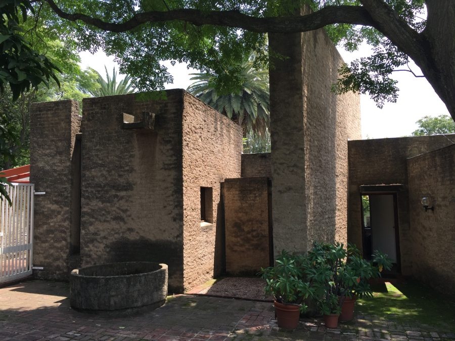 """Villa's home has been described by the specialist in the history of architecture in JHB, Clive Chipkin, in the following words: """"Low tranquil living areas contrast with unexpected explosions of multi-volume space that give the small house a monumental, perhaps exaggerated, sculptural presence half- hidden amongst established trees."""""""