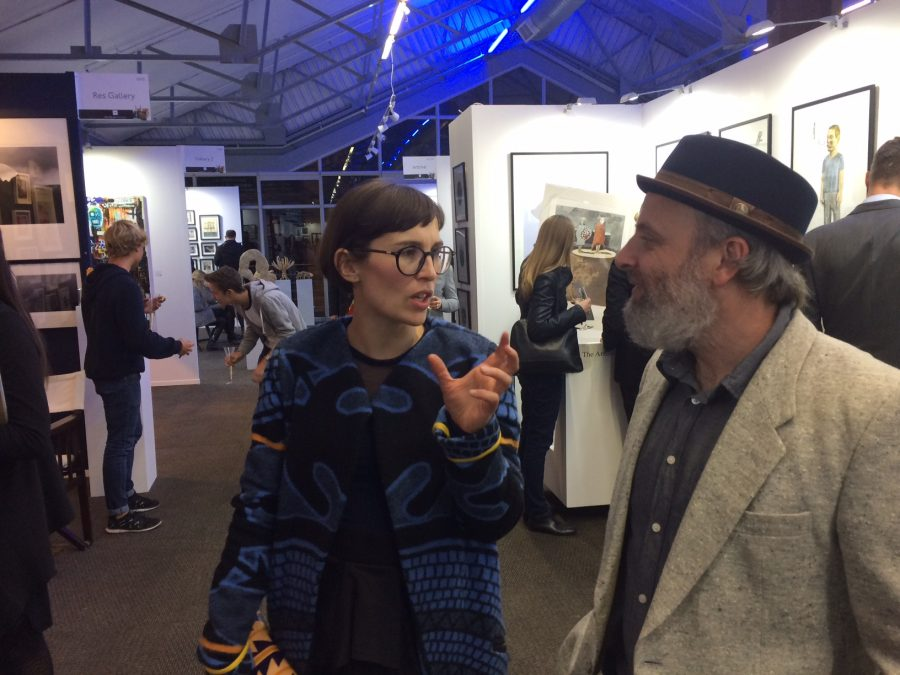 DKW master printer Jill Ross chats art with artist Richard Penn by our booth