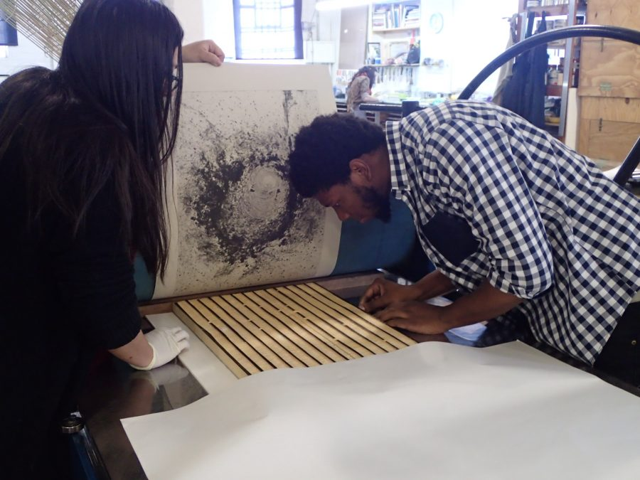 Pressure's on: Khulu and Cortez register the block to align with the carborundum print to test the layering idea