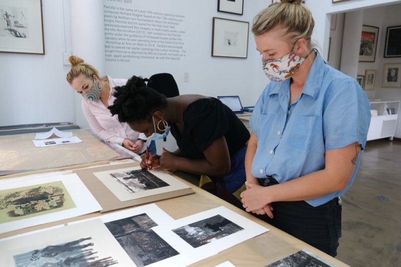 Helena signing her prints with printer Roxy Kaczmarek and gallerist Britt Lawton at David Krut Projects, Johannesburg, 2020
